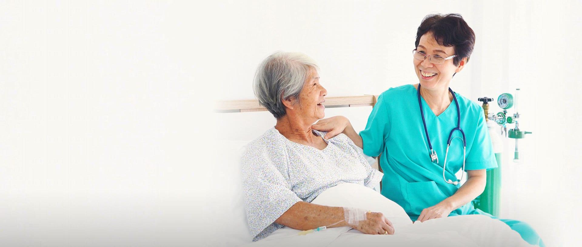 nurse and senior patient talking